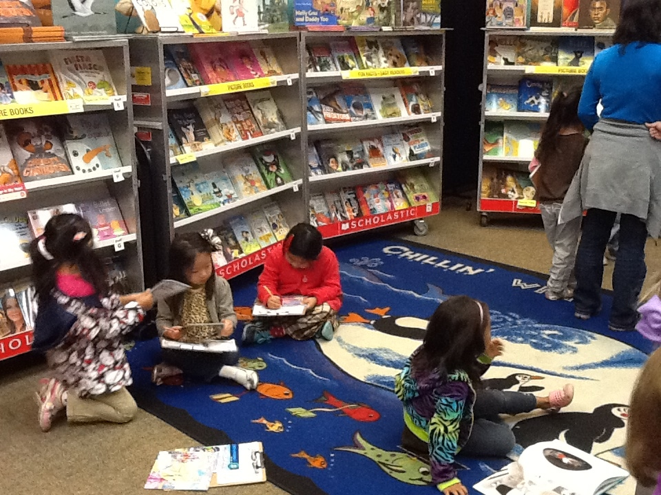 Students making wish lists at the book fair!